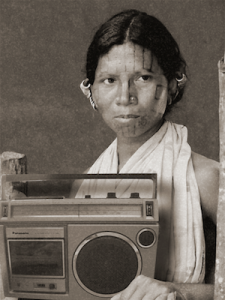 A woman holding a large radio