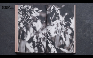 book pages showing black and white images of plants